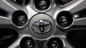 The Toyota Motor Corp. logo is seen on a tire wheel of an Avensis sedan at Toyota's headquarters in Tokyo, Japan, Aug. 2, 2011. (AP / Shizuo Kambayashi)