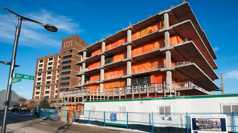 The future home of River City, a large shopping and condo building, right, is being built next to Clinskill Manor, a Saskatoon Housing Authority apartment building, in Saskatoon, Thursday, February 2, 2012.