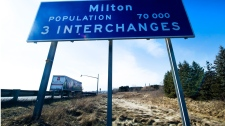 A road sign showing the population of Milton, Ont., is shown on Wednesday, Feb. 8, 2012. According to 2011 census figures, Milton had the highest population growth rate in Canada.