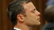 Oscar Pistorius reacts to murder trial verdict