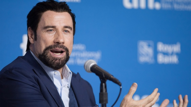 Actor John Travolta speaks during a press conference for the movie 'The Forger' at the 2014 Toronto International Film Festival on Friday, Sept. 12, 2014. (Hannah Yoon / THE CANADIAN PRESS)