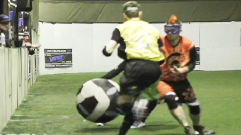 Players compete in a game of Ultimate Taser Ball, in which players try to score goals, while avoiding tackles and Tasers.