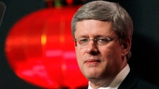 Prime Minister Stephen Harper delivers his speech in Guangzhou, China, Friday, Feb. 10, 2012. (AP / Kin Cheung)