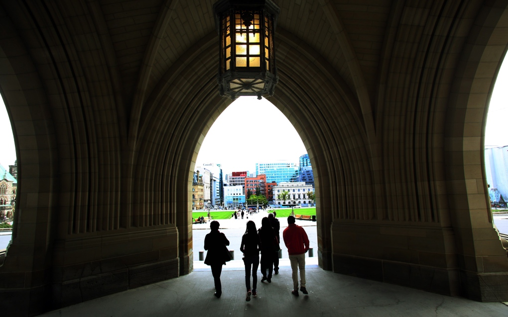 Tourists leave the Parliament buildings
