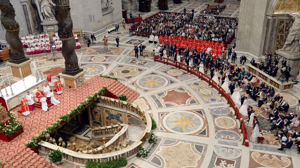 Pope Francis, left beneath a baldachin, weds twenty couples inside St. Peter's Basilica, at the Vatican, Sunday, Sept. 14, 2014. (AP / Alberto Pizzoli)