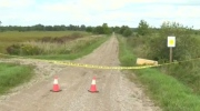 Police tape on a road in Clinton, ON.