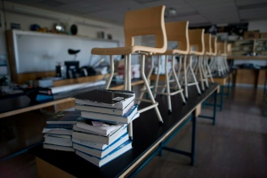 Chairs are seen on top of desks in a physics lab at McGee Secondary school in Vancouver, B.C. Friday, Sept. 5, 2014. (Jonathan Hayward/The Canadian Press)