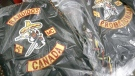 Bandidos biker gang jackets displayed at a joint OPP and Winnipeg police news conference on June 16, 2006. (CP / John Woods)