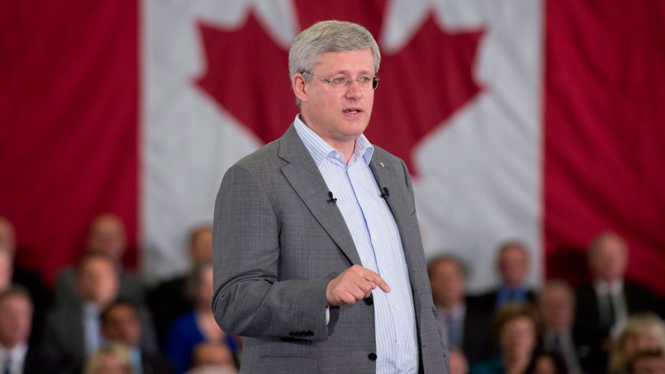 Prime Minister Stephen Harper speaks about the upcoming session of Parliament during a speech to supporters, in Ottawa, Monday, Sept. 15, 2014. (Adrian Wyld / THE CANADIAN PRESS)
