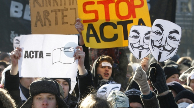 Activists protest against the Anti-Counterfeiting Trade Agreement, or ACTA, in front of the Government palace in Vilnius , Lithuania, Saturday, Feb. 11, 2012. (AP Photo/Mindaugas Kulbis)