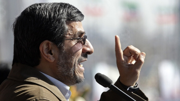 Iranian President Mahmoud Ahmadinejad gestures as he deliver his speech at a rally to mark the 33rd anniversary of the Islamic Revolution that toppled the country's pro-Western monarchy and brought Islamic clerics to power, Tehran, Saturday, Feb. 11, 2012. (AP Photo/Vahid Salemi)