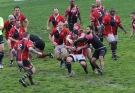 Boston Ironside rugby team player, centre, is tackled by Amsterdam lowlanders players during the Bingham Cup gay rugby tournament in Sydney, Australia, Friday, Aug. 29, 2014. T(AP Photo/Rob Griffith)