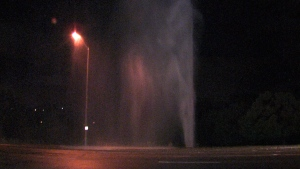 Water shoots high into the air following a water main break in Brampton, Tuesday, Sept. 16, 2014.