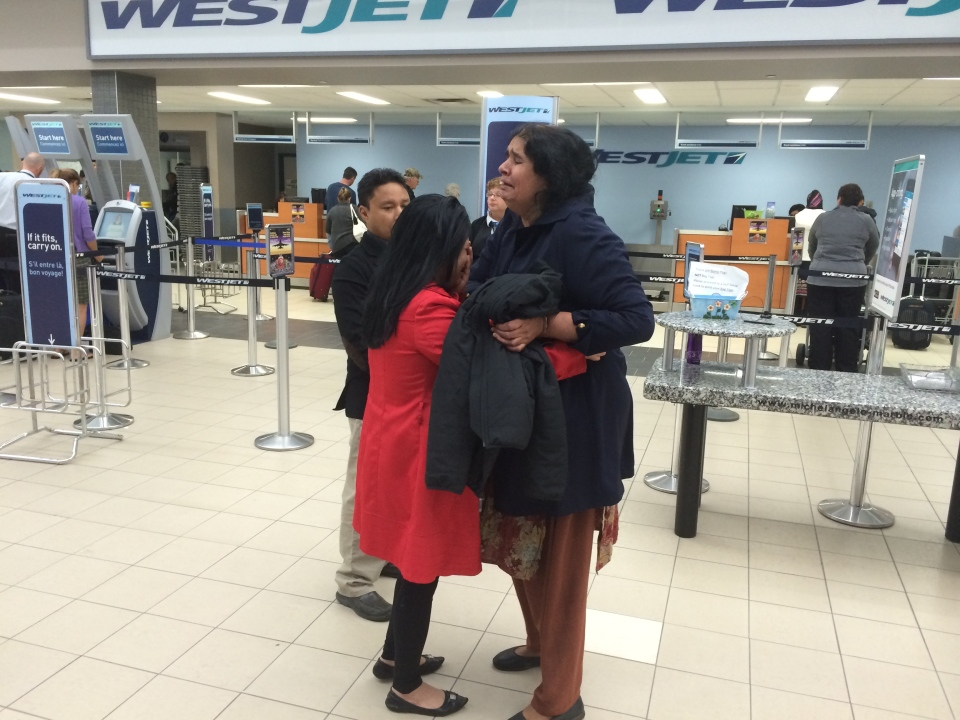 Jamila Bibi (right) says goodbye to supporter Sahana Yeasmin Tuesday morning at the Saskatoon airport.