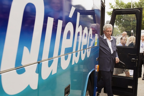 Bloc Quebecois leader Gilles Duceppe steps of his campaign bus at a local riding office in Longueuil, Quebec on Saturday, Sept. 6, 2008. (Paul Chiasson / THE CANADIAN PRESS)