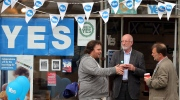 Members of the public are seen talking outside of a shop that has been set up to promote Yes voters in Dunbar, Scotland, Tuesday, Sept. 16, 2014. (AP / Scott Heppell)