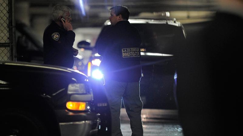 Whitney Houston dead, Whitney Houston death, A coroner investigator works at the Beverly Hilton Hotel, Saturday, Feb. 11, 2012. (AP / Mark J. Terrill)