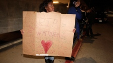Whitney Houston dead, Whitney Houston death, Annika Sillemon, 8, fan of Whitney Houston, stands outside the Beverly Hilton Hotel Saturday, Feb. 11, 2012. (AP / Jae C. Hong)
