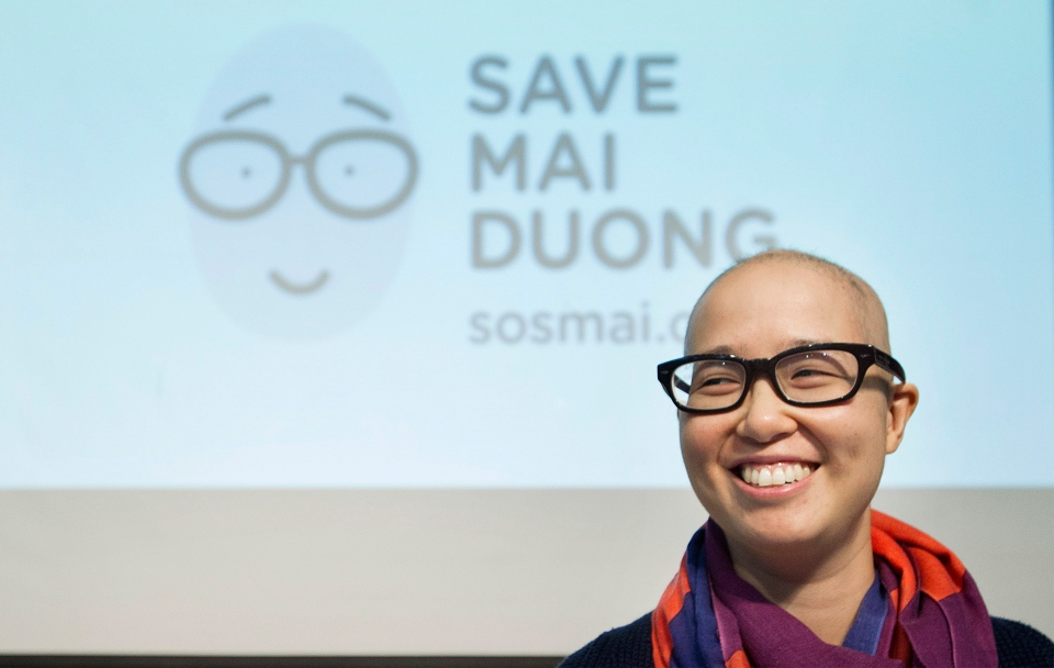 Mai Duong smiles following a news conference in Montreal, Tuesday, Sept. 16, 2014. (Graham Hughes / THE CANADIAN PRESS)