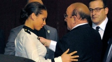 Whitney Houston dead, Whitney Houston death, Alicia Keys, left, hugs Clive Davis at the loading dock outside the Beverly Hilton Hotel, Saturday, Feb. 11, 2012, in Beverly Hills, Calif. (AP / Mark J. Terrill)