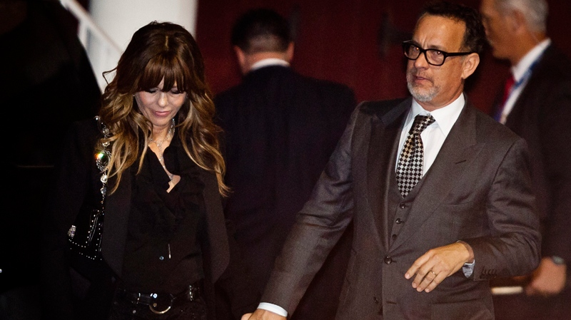 Whitney Houston dead, Whitney Houston death, Tom Hanks and his wife Rita Wilson leave the pre-Grammy Gala at the backdoor of the Beverly Hills Hilton hotel in Beverly Hills, Calif. Saturday, Feb. 11, 2012. (AP / Bret Hartman)