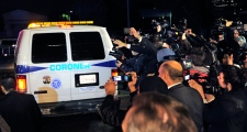 Media mobs a coroner's van as it leaves the Beverly Hilton Hotel, early Sunday, Feb. 12, 2012. (AP / Mark J. Terrill)