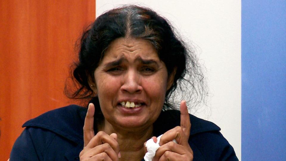 Jamila Bibi tears up as she awaits deportation to Pakistan in the Saskatoon airport on Tuesday, Sept. 16, 2014.