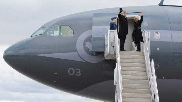 Prime Minister Stephen Harper departs with wife Laureen from Ottawa on Friday, November 11, 2011, on route to Honolulu, Hawaii.