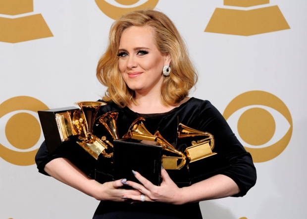 Adele poses backstage with her six awards at the 54th annual Grammy Awards on Sunday, Feb. 12, 2012 in Los Angeles. (AP / Mark J. Terrill)
