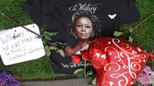 A T-shirt, flowers and notes are left at a makeshift memorial for Whitney Houston outside the Beverly Hills Hilton Hotel in Beverly Hills, Calif., Monday, Feb. 13, 2012. (AP / Damian Dovarganes)