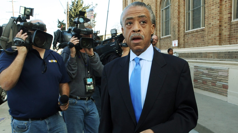 Rev. Al Sharpton leaves after leading a prayer for Whitney Houston, during regular Sunday services at Second Baptist Church in Los Angeles, Sunday, Feb. 12, 2012. (AP / Reed Saxon)