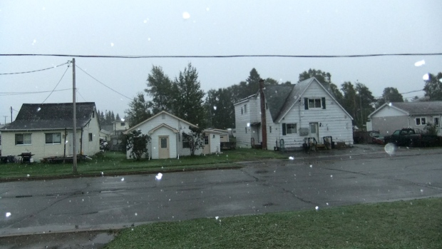 Snow falls on a street in Wawa, Ont., on Wednesday, Sept. 17, 2014. (Sharlane Jackson / MyNews)
