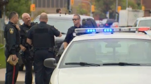 Winnipeg police investigate on Balmoral after a man was stabbed near Graham and Vaughan on Sept. 17, 2014.