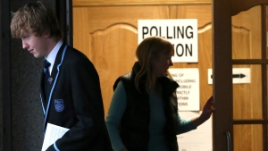 Voters leave after casting their ballots at Ritchie Hall in Strichen, Scotland, Thursday, Sept. 18, 2014. (AP / Scott Heppell)