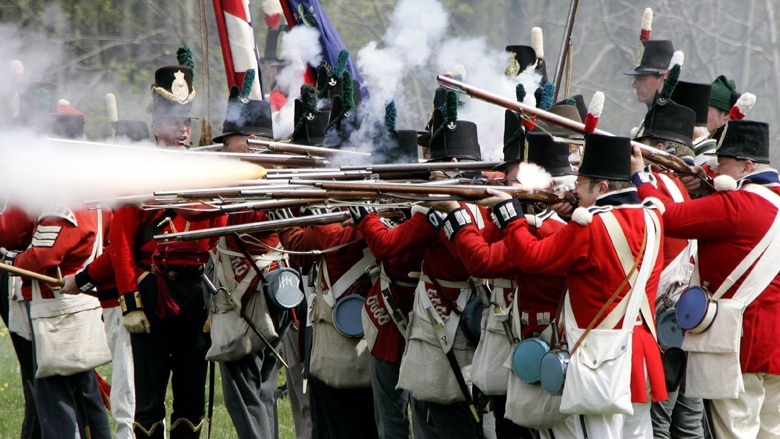 In this May 5, 2007 file photo, British soldiers fire their muskets at the American forces during a re-staging of a War of 1812 battle near its actual site west of London, Ontario.  THE CANADIAN PRESS/Dave Chidley