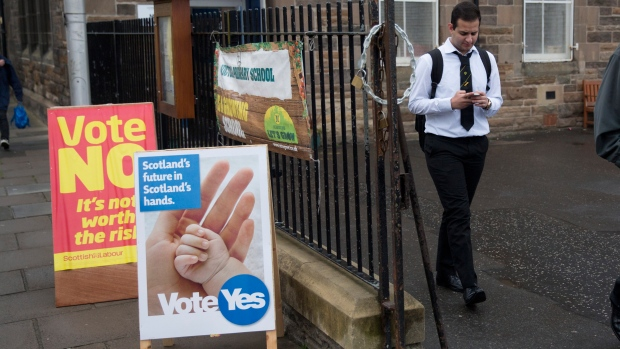 A school pupil walks away from a polling place after casting his vote, as anyone aged over 16 can vote in the Scottish independence referendum, in Edinburgh, Scotland, Thursday, Sept. 18, 2014. (AP / Matt Dunham)