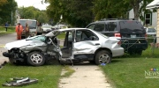 Bystanders subdue driver armed with knife at crash