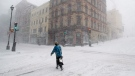 A person walks through a spring snow storm in Halifax Wednesday, March 26, 2014. (Andrew Vaughan / THE CANADIAN PRESS)