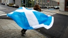 A young girl runs around a street pole with a Scottish national flag before taking part in a demonstration in favor of Scottish independence in Brussels on Thursday, Sept. 18, 2014. (AP / Virginia Mayo)