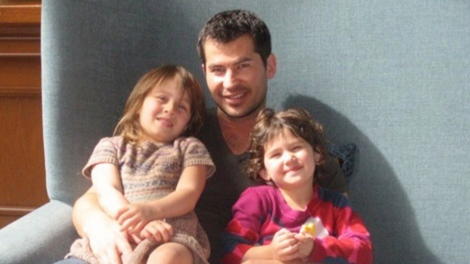 Randy Lambert and his two daughters are seen in a family photo. (CTV)