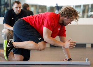 Calgary Flames goalie Karri Ramo, from Finland, performs a test as he attends the opening day of NHL training camp in Calgary, Alta., Thursday, Sept. 18, 2014. (THE CANADIAN PRESS/Jeff McIntosh)