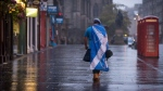 A lone YES campaign supporter walks down a street in Edinburgh after the result of the Scottish independence referendum, Scotland, Friday, Sept. 19, 2014.  (AP / PA, Stefan Rousseau)
