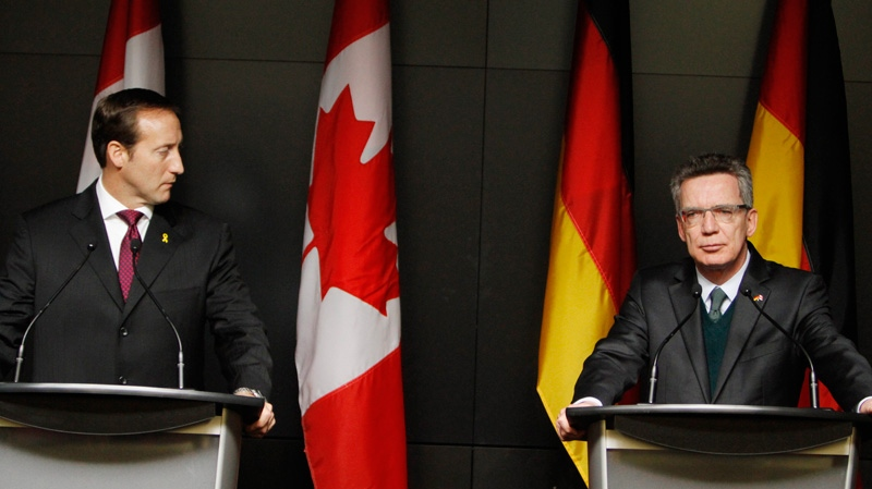 German Defence Minister Dr. Thomas de Maiziere, right, and Defence Minister Peter MacKay take part in a joint news conference following bilateral talks in Ottawa, Tuesday Feb. 14, 2012. (Fred Chartrand / THE CANADIAN PRESS)