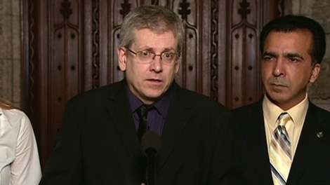NDP MP Charlie Angus speaks to the media in the foyer of the House of Commons on Parliament Hill in Ottawa, Tuesday, Feb. 14, 2012.