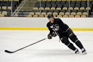 Pittsburgh Penguins' Sidney Crosby skates during the first day of training camp in Pittsburgh, Friday, Sept. 19, 2014. (AP / Keith Srakocic)