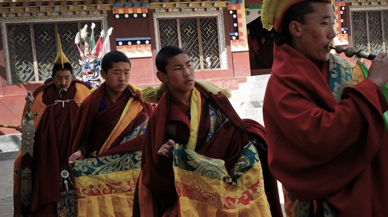 In this photo taken Tuesday, Feb. 7, 2012, Tibetan monks perform a religious ceremony at a monastery in Jiuzhaigou, in northwestern China's Sichuan province. Sichuan province's Aba prefecture has been the scene of numerous protests over the past several years as well as recent surges of dramatic demonstrations against the Chinese government. (AP Photo/Andy Wong)