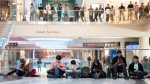 People wait in line to buy the new iPhone 6 at the Eaton Centre in Toronto, Ont. on Friday, Sept. 19, 2014 (Hannah Yoon / THE CANADIAN PRESS)