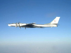 In this photo released by the U.S. Navy, one of two Russian Tupolev 95 Bear long range bomber aircraft is seen near the U.S. Navy aircraft carrier USS Nimitz south of Japan, on Feb. 9, 2008. (AP / U.S. Navy)