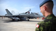 A Canadian soldier looks at a CF-18 as it sits loaded for flight at Camp Fortin on the Trapani-Birgi Air Force Base in Trapani, Italy, on Thursday, Sept. 1, 2011. (The Canadian Press/Sean Kilpatrick)