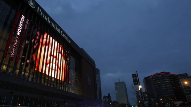 A tribute to Whitney Houston is displayed on the large video board outside the Prudential Center in Newark, N.J., Tuesday, Feb. 14, 2012. (AP Photo/Rich Schultz)